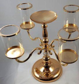 Candeliere a quattro fiamme con piattino centrale oro